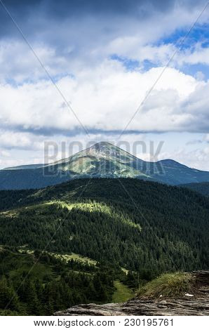 Clouds Over The Mountains. Mountain Landscape. Vertical Shot