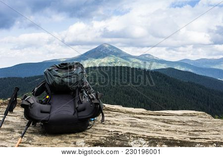 Necessary Equipment For Hikes. Tourist Backpack. Trekking Sticks