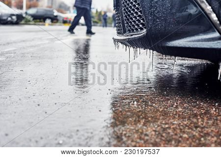 Parking Lot With Winter Icy-covered Road And Part Of The Car