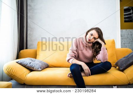 Picture Of A Tired Unkempt Woman Sitting On He Couch At Home. Girl Watch Tv New Serial. Sofa Relax C