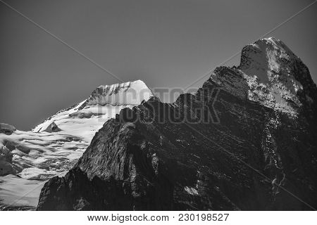 Black And White Photo Of Eiger In Black And Mönch In White, Contrasting Against Each Other (swiss Al