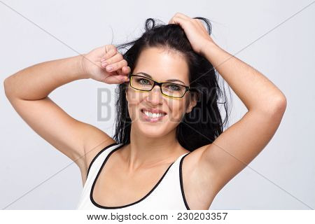 Beautiful Young Woman Wearing Glasses With A Smille