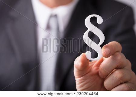 Businessperson Holding Paragraph Symbol