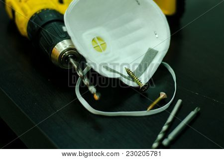 Drill, Respirator And Screws On The Table