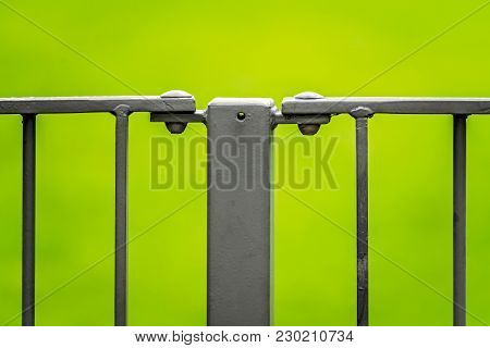 Metal Gate Fence Detail Over Green Background