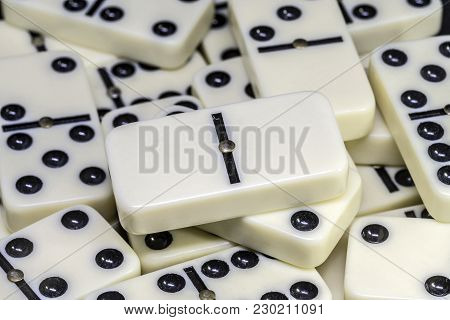 Dominoes Is A Family Of Board Games , The Game Is Played With Dominoes Tiles Which Are In The Photo