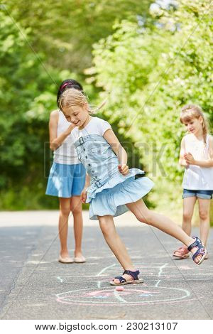 Girls playing hopscotch for good skills training and have fun