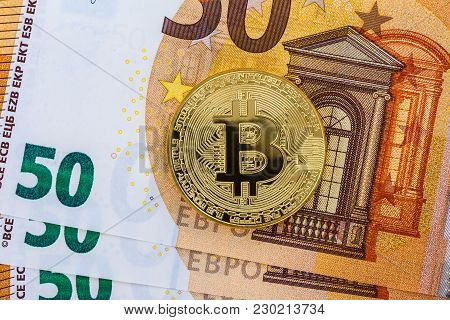 Golden Bitcoin With Fifty Euro Banknotes As Background