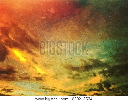 Apocalyptic Grunge Sunset Sky And Clouds Background. Dusty Scratched Texture.