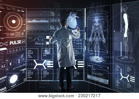 Progressive Doctor. Smart Qualified Experienced Doctor Standing In Front Of A Giant Transparent Scre