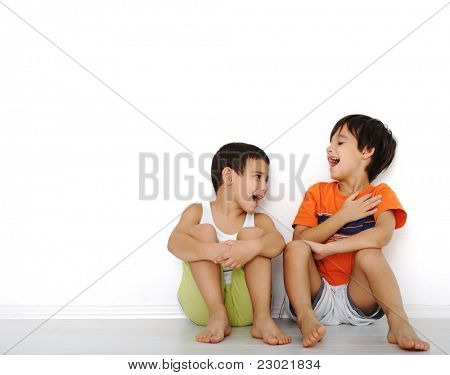 Happy children sitting at home, indoor