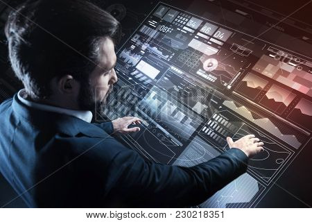 Convenient Screen. Calm Serious Responsible Programmer Looking Careful While Standing In His Elegant