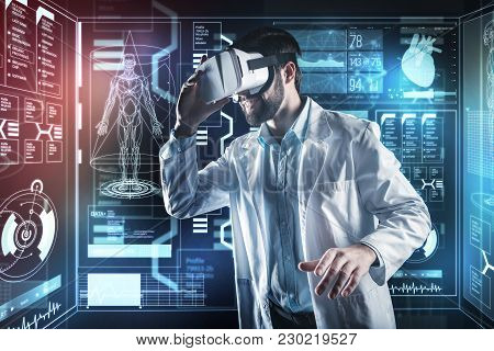 Virtual Reality. Progressive Smart Cheerful Doctor Feeling Excited While Wearing Modern Virtual Real