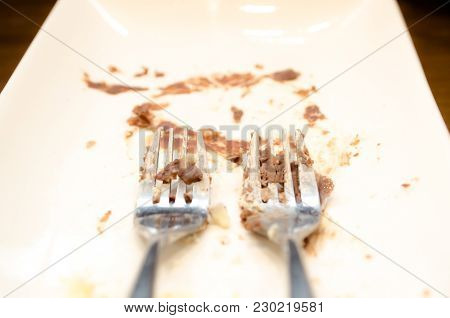 Dirty Twin Fork And White Plate After Eat Cake. / Mess Up Dish / Copy Space For Text.