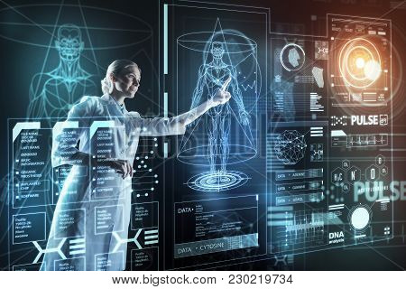 Using Gadgets. Clever Experienced Progressive Doctor Feeling Satisfied With Futuristic Technologies