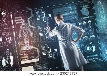 One Touch. Calm Clever Experienced Doctor Carefully Pointing To A Transparent Screen While Being In
