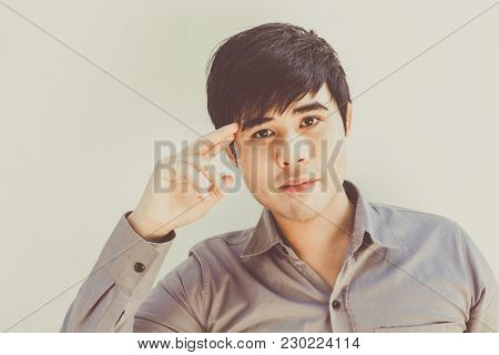 Portrait Of Asian Male Model On White