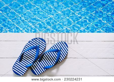 Blue Flip-flops On The Swimming Pool Background