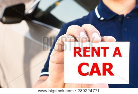 Man Hand Showing Rent A Car Sign