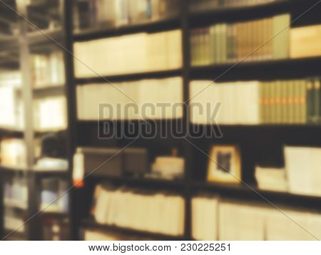 Books On Bookshelf In Library Blur Background