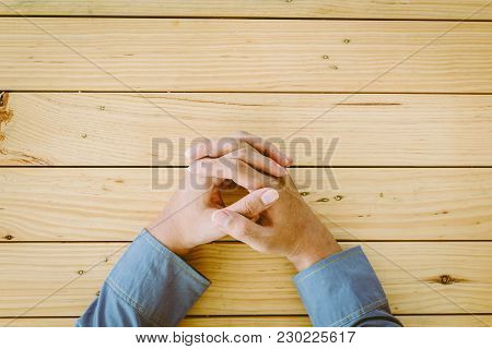 Businessman On Seated At The Table Office