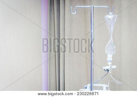 Infusion Bottle With Iv Solution In Hospital