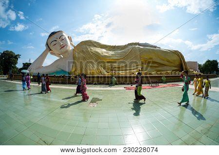 Bago, Myanmar - November 5, 2016: People Walking Around Reclining Buddha Name Naung Daw Gyi Mya Tha