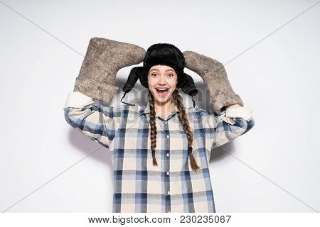 Happy Russian Woman In A Cap With Ear-flaps Holds Valenki