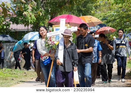 Chiangrai, Thailand - February 24: Unidentified Crowd People Walking To The Graveyard With Cross On