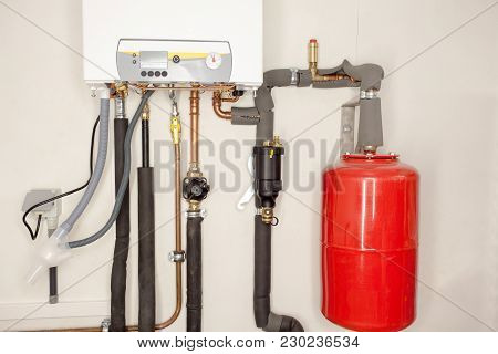 The Bottom Of The Boiler Is Closed With Connection To Central Heating And Hot Water Whit An Expansio