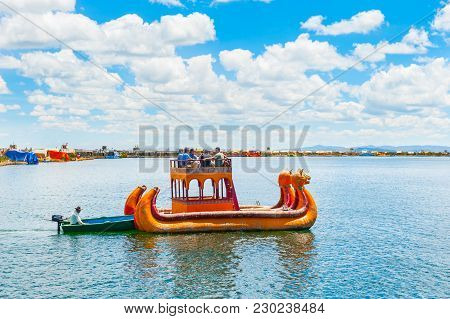 Titicaca Lake, Puno, Peru - March, 20, 2017. Traditional Totora Boat With Tourists Near Uros Floatin