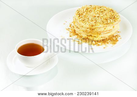 Cup Of Tea, Puff Homemade Cake With Custard And Biscuit Crumb