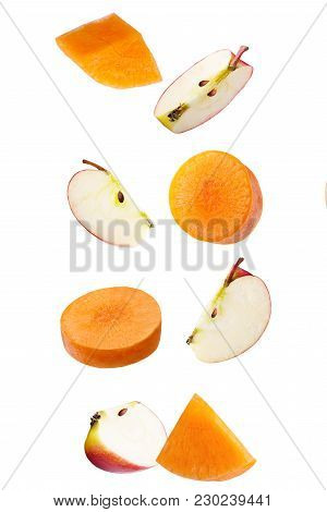 Isolated Falling Fruits. Falling Apple And Carrot Isolated On White Background With Clipping Path As