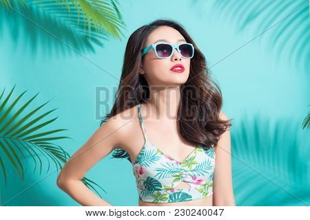 Portrait Beauty Sexy Asian Model With Perfect Face Wearing A Sunglass And Elegant Bikini On Palm Tre