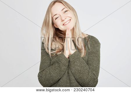 Studio Portrait Of Annoyed And Disgusted Young European Woman Wearing Stylish Clothing Expressing Di