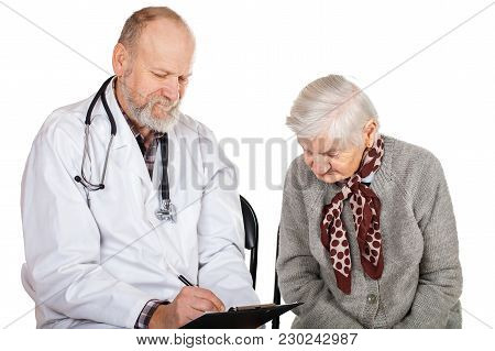 Mature Male Doctor Taking Care Of Disabled Old Woman On Isolated Background