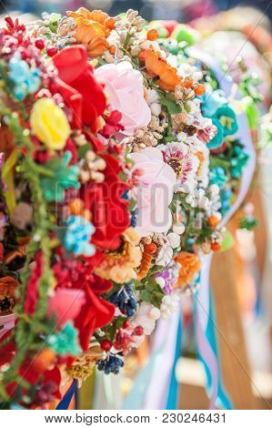 Joyous Colorful Hair Accessories Hanging On The Counter At A Street Fair. Close Up. Selective Focus.