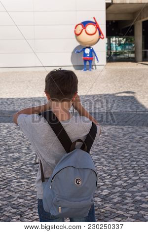 Lisbon, Portugal - July 2016:  8 Years Child Taking Photos In Front Of Lisbon Oceanarium Entrance, N