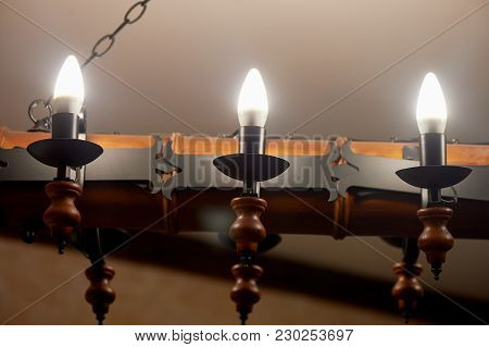 Ceiling Light And Wooden Beams On The Ceiling. The Atmosphere Of The Village Pub