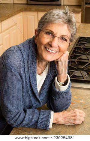 Portrait Of A Confident Mature Older Woman At Home.