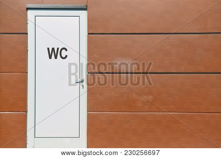 Closeup Of The Front Door Of A Public Toilet With Text Wc