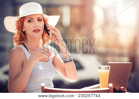 Beautiful Woman Working On Laptop At Restaurant.