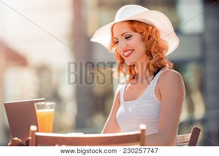 Business Woman Sitting And Relax In Cafe With Laptop