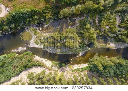 Aerial View Of A River Crossing A Temperate Deciduous Forest