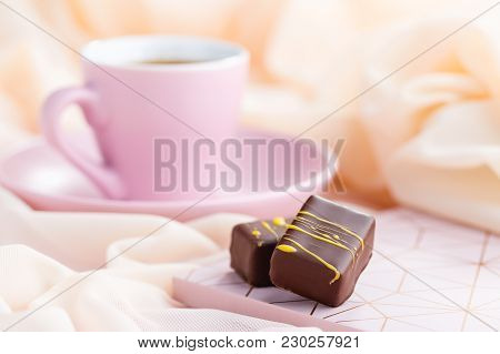 Luxury Bonbons With Cup Of Coffee On Pastel Pink Background. Exclusive Handmade Chocolate Candy. Spr