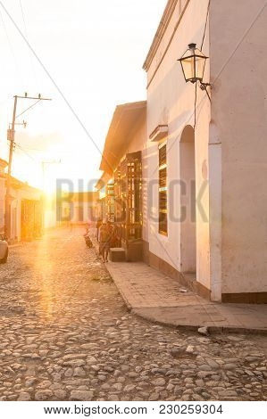 Trinidad, Cuba - January 4, 2017: Tropical Sunset In A Colonial Street. Urban Scene In Colonial Town