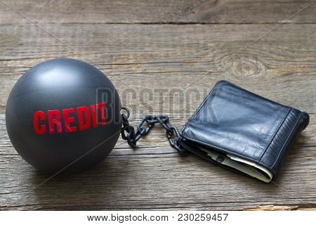 Slave And Shackle Of Credit  Business Concept With Iron Ball And Wallet