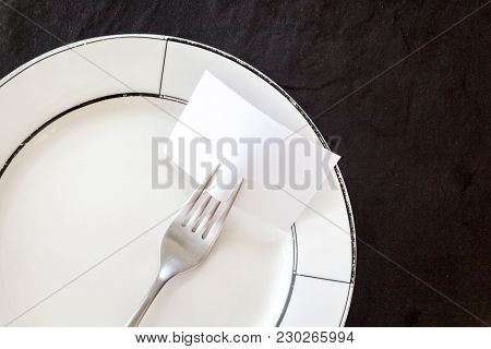 Empty Note Paper Attached To Fork On Black