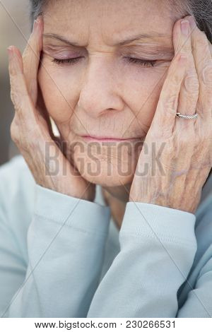 Mature Elderly Woman Feeling Lonely And Depressed.