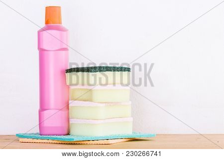 Cleaning Items And Housework Concept On A Wooden Table Background